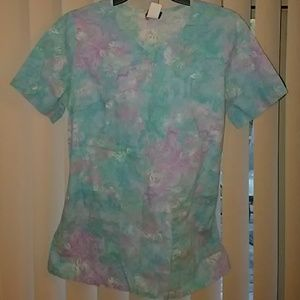 Colorful flower scrub top